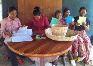 TPO considers economic, social and cultural factors part of people's well-being – pictured: a savings group meeting supported by TPO.