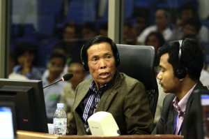 A TPO Counselor (right) provides psychological support to a civil party and Khmer Rouge survivor during legal proceedings at the ECCC.