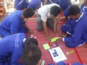 A TPO counselor facilitates an activity from the Life Skills Program for young inmates.